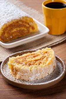 Swiss roll cake stuffed with dulce de leche. roulade cake.