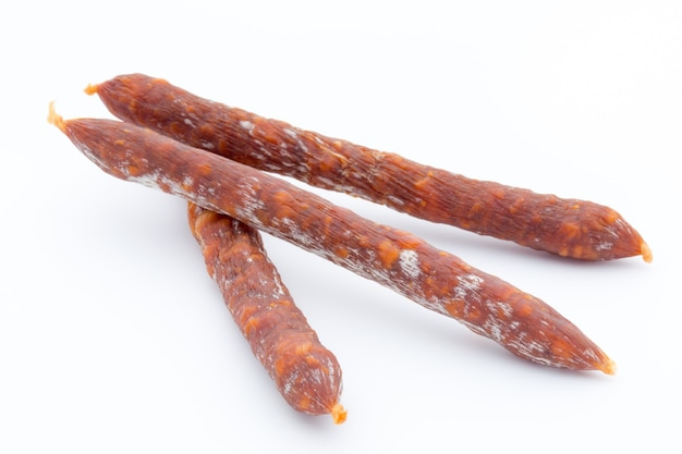 Swiss style peperoni or salami, parsley sausage. isolated on white background.