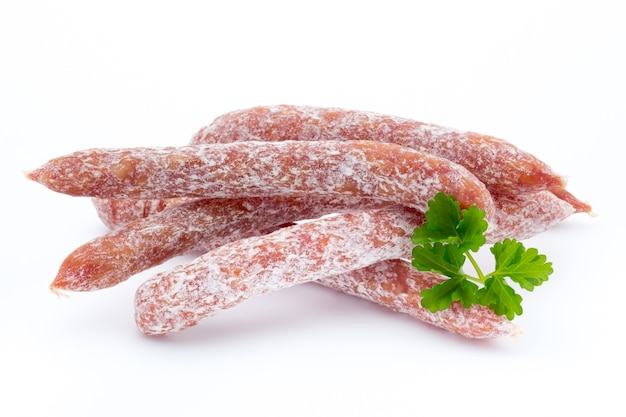 Swiss style peperoni or salami, parsley sausage. isolated on white surface.