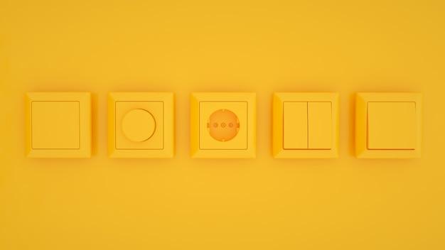 黄色の背景で隔離のスイッチとソケット