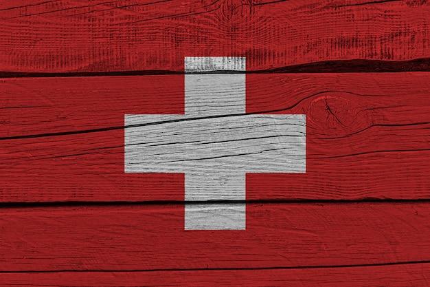 Switzerland flag painted on old wood plank