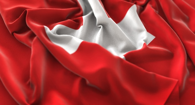 Switzerland flag ruffled beautifully waving macro close-up shot