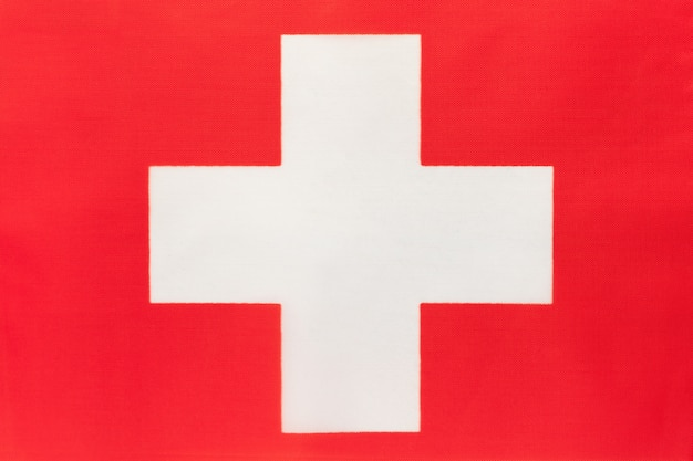 Switzerland national fabric flag, textile background
