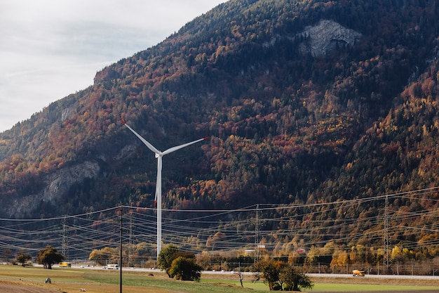 Switzerland, wind power plant against the background of alpine mountains