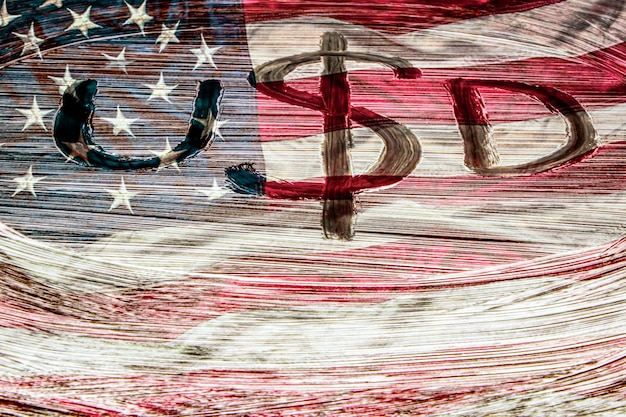 Symbol of the american currency on the background of the usa flag. dollar symbol hand-painted with a brush. design concept for business and politics.