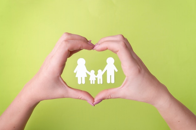 Symbol of a friendly family protecting health, a family of white paper.