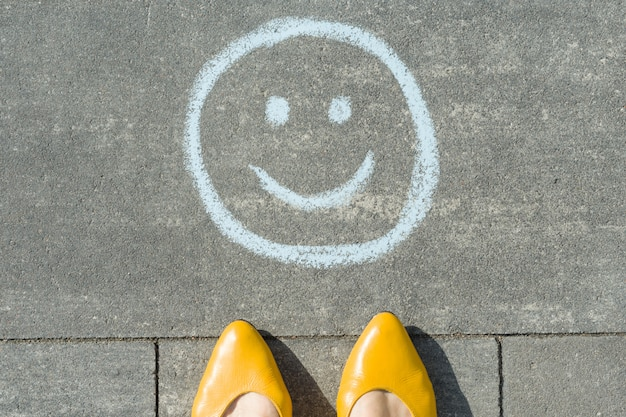 Symbol of happy smiley drawn on the asphalt