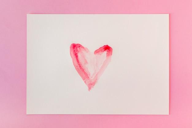 Symbol of heart on white paper
