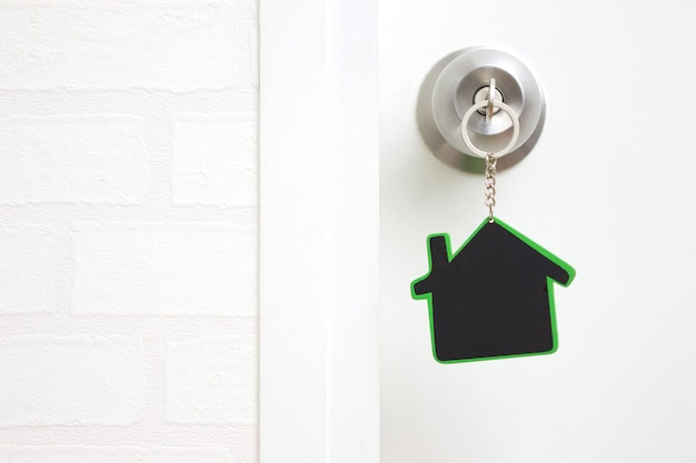 Symbol of the house and stick the key in the keyhole with copy space