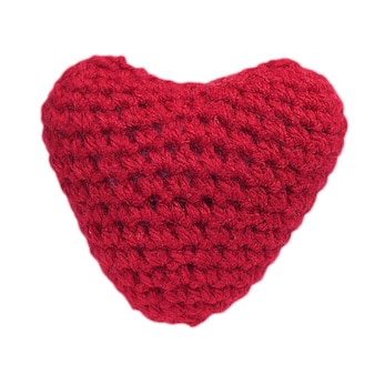 Symbol of love crochet red hearts on white background.