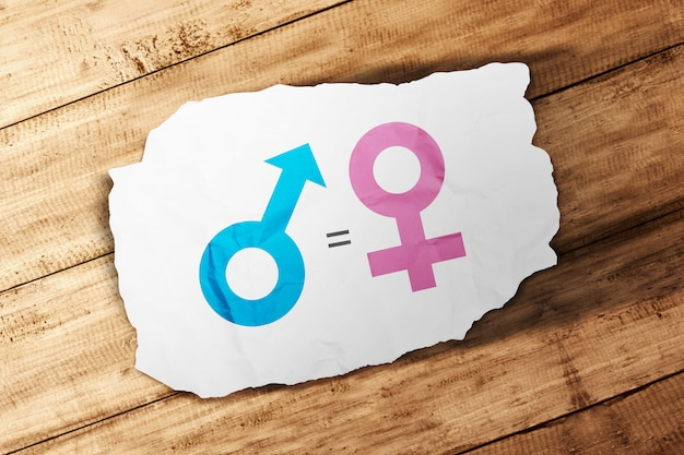 Symbol of male gender is equal to female in white paper on wooden table