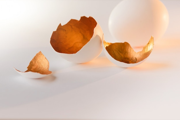 A symbol of new life, eggs shells. decorative, gold color inside