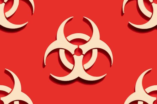 Символ предупреждения о биологической опасности на красном фоне. вирус эпидемии коронавируса. биологическая опасность, радиоактивные, токсичные отходы.