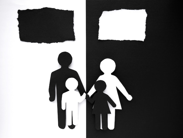 Symbol of a person and family cut out of black and white paper. mixed race marriage