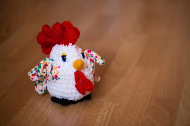 Symbol of the year, the year of the rooster. knitted cock, isolate.