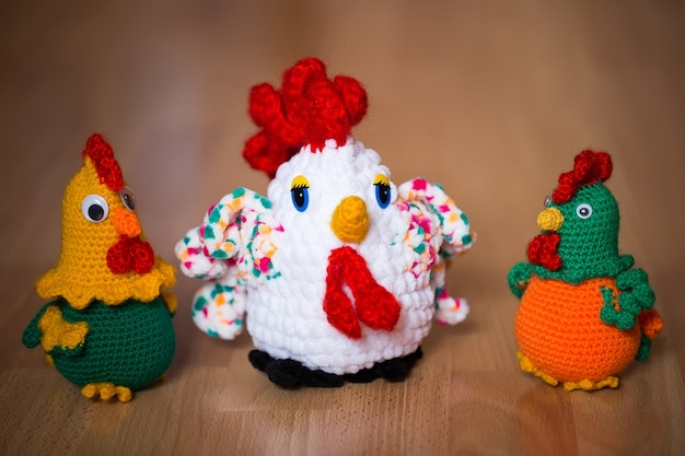 Symbol of the year , the year of the rooster. knitted cock, isolate.