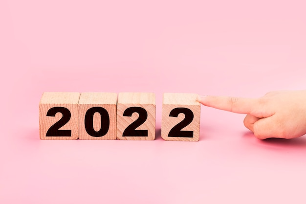 Symbolize the change from 2021 to the new year 2022 2022 happy new year concept