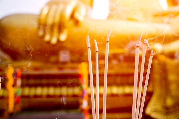 Symbols of buddhism. burning incense sticks. south-eastern asia. details of buddhist temple in thailand.
