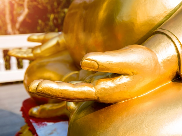 Symbols of buddhism. hands of buddist statues. south-eastern asia. details of buddhist temple in thailand.