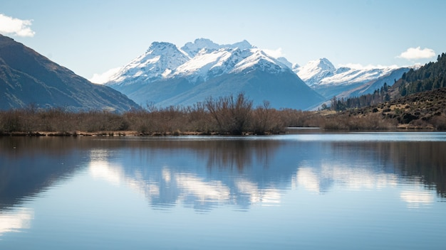 Symetric landscape shot with mountain reflected in lakeshot made in glenorchy new zealand