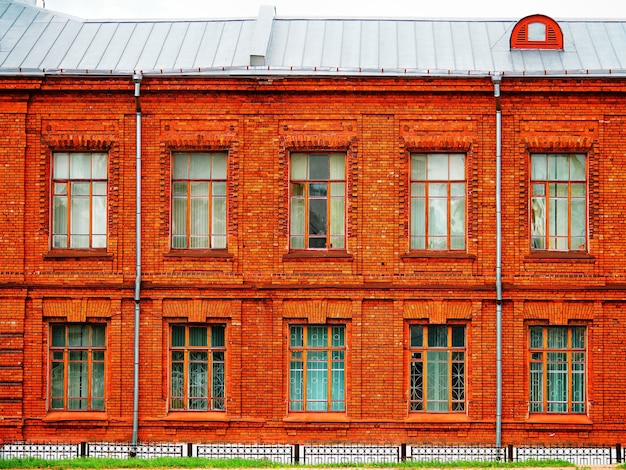 Symmetric front side of brick house architecture background