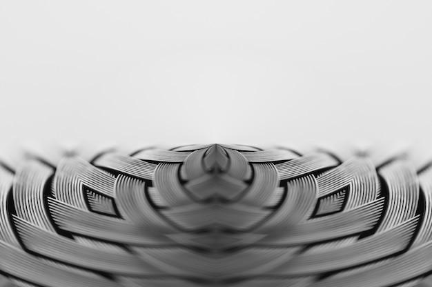 대칭은 금속 고리 버들 세공 텍스처 클로즈업입니다. 볼륨 철강 표면의 세부 배경입니다. 매크로에서 추상 회색 꼰된 철사입니다. 복사 공간 초현실적 인 모양입니다. 특이한 흑백 공간.