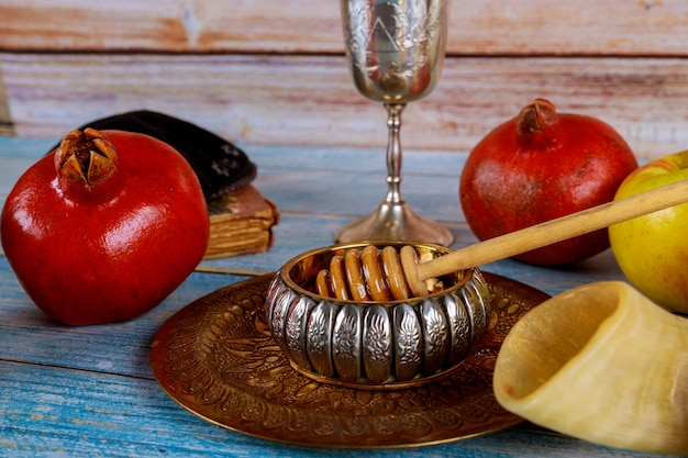On the synagogue are the symbols of rosh hashanah apple and pomegranate, shofar