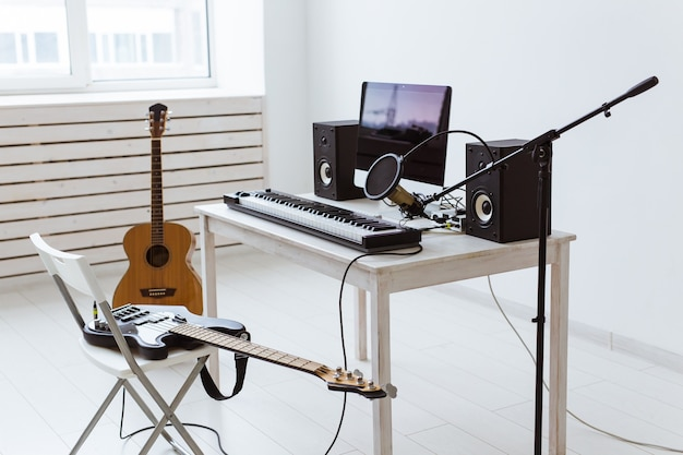 Synthesizer keyboard digital recording and guitars, home music record studio concept. leisure and
