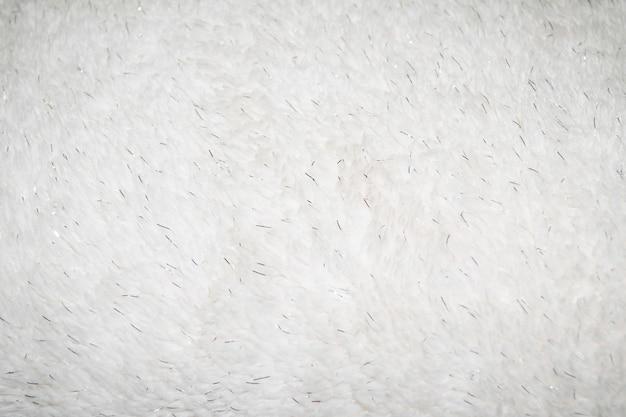 銀の要素を持つ背景の合成毛皮の白いテクスチャ