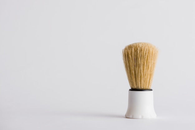 Synthetic shaving brush on grey background