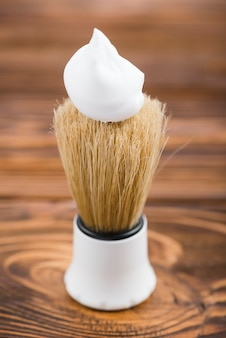 Synthetic shaving brush with on wooden table