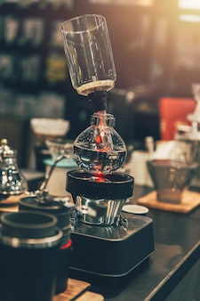 Syphon coffee maker cafe in coffee shop vintage color