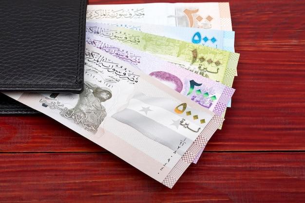 Syrian money in a black wallet