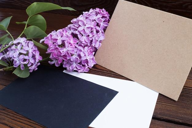 Syringa flowers on wooden table.