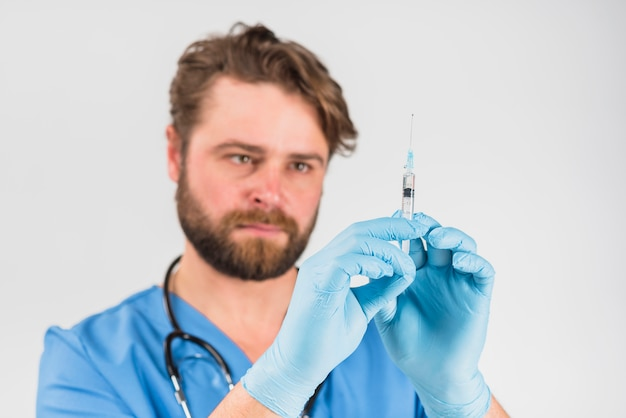 Syringe in hands with gloves of nurse man
