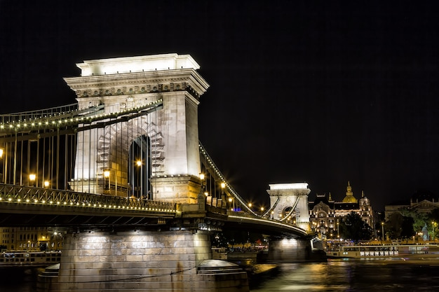 Szechenyi chain bridge at night in the city of budapest, hungary