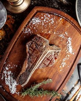 T bone steak topped with salt