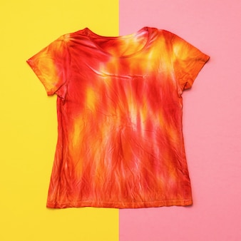 T-shirt in bright colors in tie dye style. flat lay. staining fabric in tie dye style. flat lay.