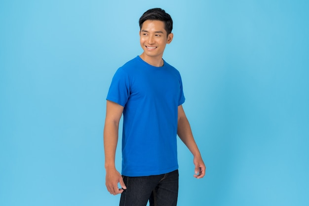 T-shirt design, young man in blue t-shirt isolated on blue