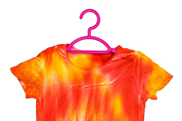 T-shirt painted in the style of tie dye on a hanger isolated. staining fabric in tie dye style.