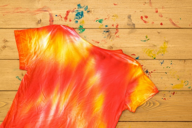 T-shirt in the style of tie dye inverted on a wooden table
