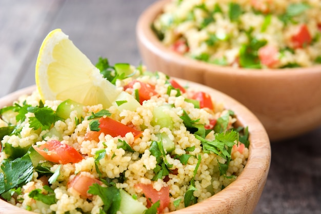 Tabbouleh salad with couscous on a rustic table