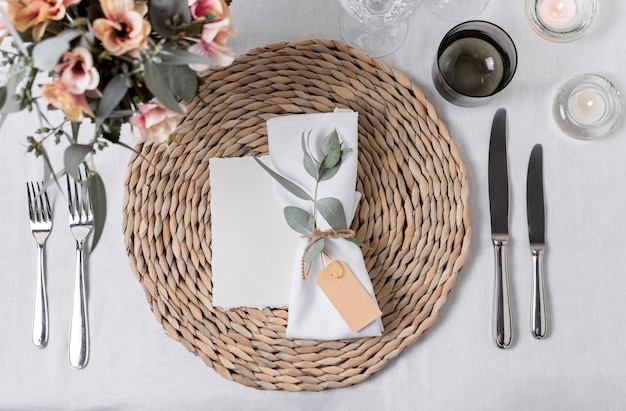 Table arrangement with flowers flat lay