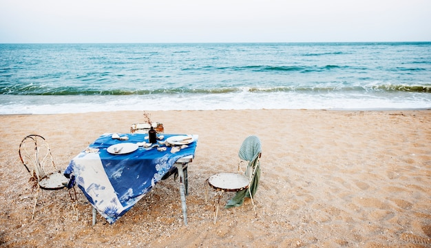 Table chairs meal sea shore holiday sky concept