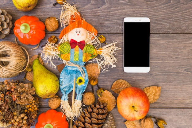 Стол, покрытый овощами и смартфоном