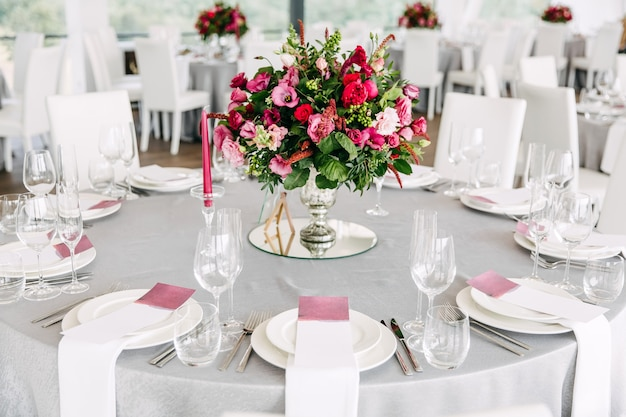 Table decorated at a wedding reception with flowers and tableware
