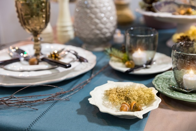 Table decorated with luxury dishes closeup, nobody