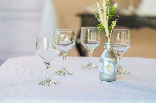 Table decoration with 4 cups and one bottle