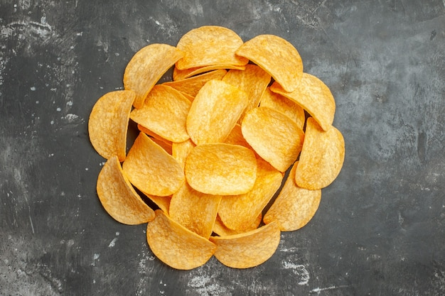 Table decoration with homemade potato chips on gray background