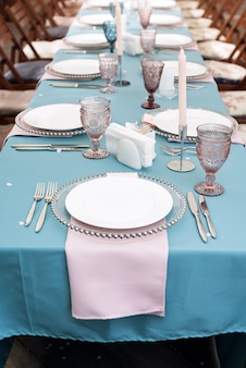 Table decorations for holidays and wedding dinner. table set for holiday wedding reception in outdoor restaurant.